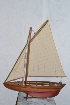 Wood Model Of A Sailboat On A Stand