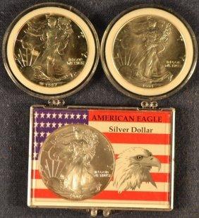 Three Silver American Eagle Coins: 1987, 1993, 2002