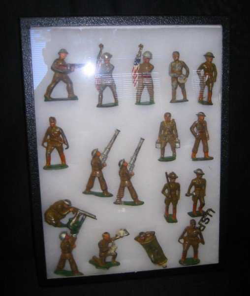 14: Seventeen metal toy soldiers in various positions.
