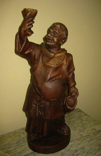 20: Continental carved oak figure of a wine Friar. 16 3