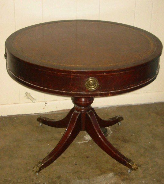 95: Duncan Phyfe style mahogany leather top drum table.
