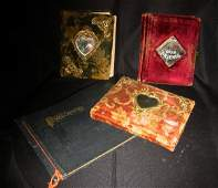 Three Victorian and vintage photograph albums.
