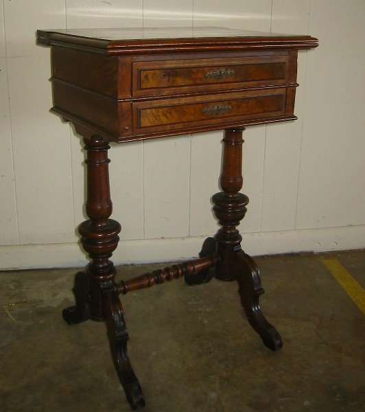 357: 19th century American figured mahogany work table.