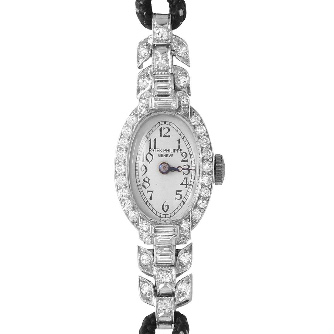 Patek Philippe Platinum Watch w/ Diamonds
