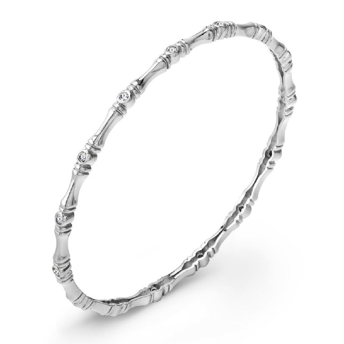 Sterling Silver Rhodium Plated and bezel set CZ Bangle