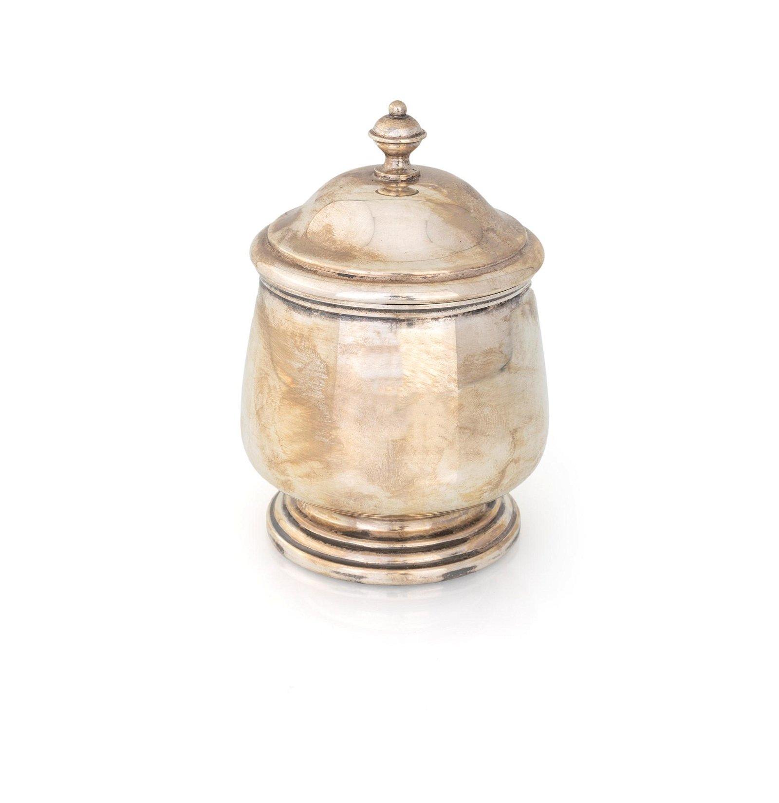 Silver circular sugar bowl with lit