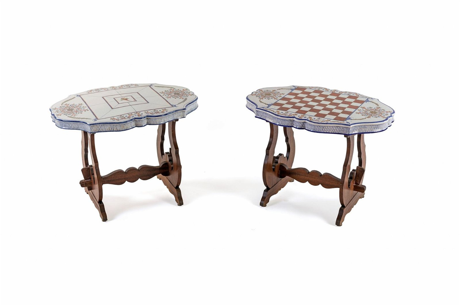 Two low tables in walnut with majolica top