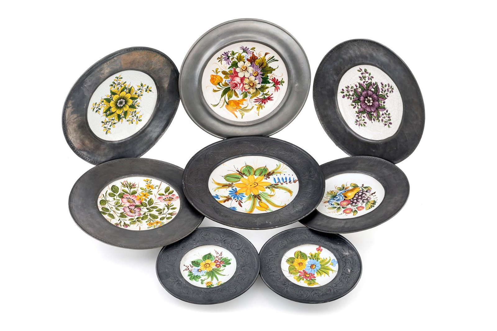 Twelve majolica and pewter plates