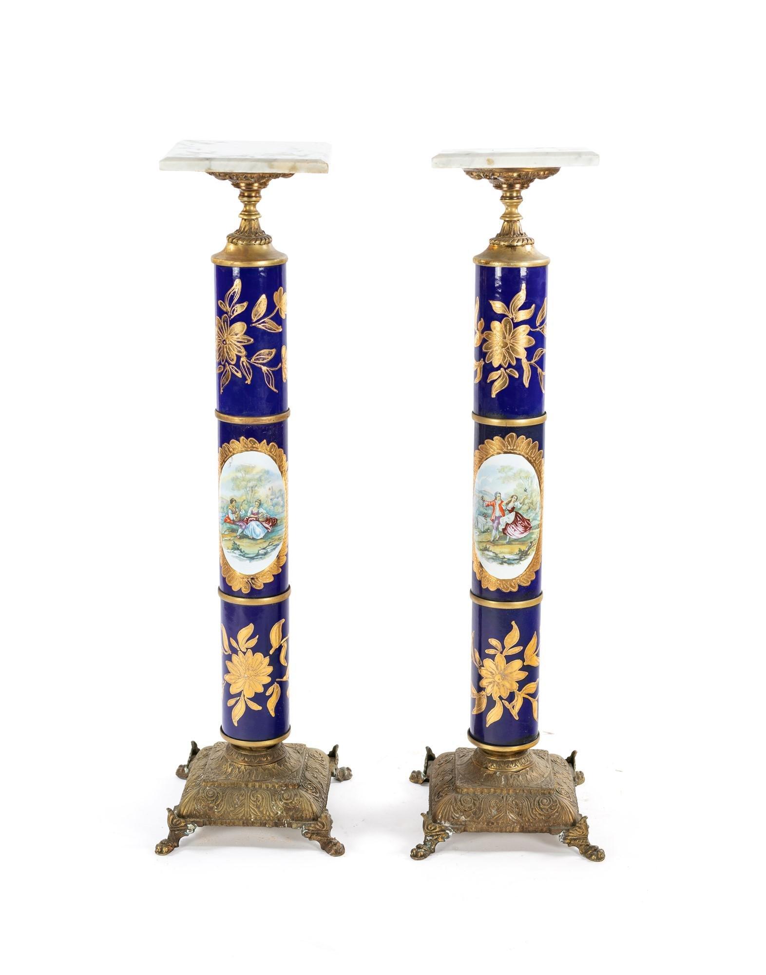 Pair of blue and golden porcelain columns