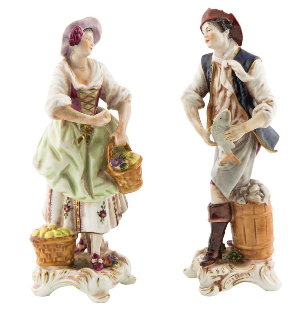 | Coppia di sculture in porcellana policroma | A Pair