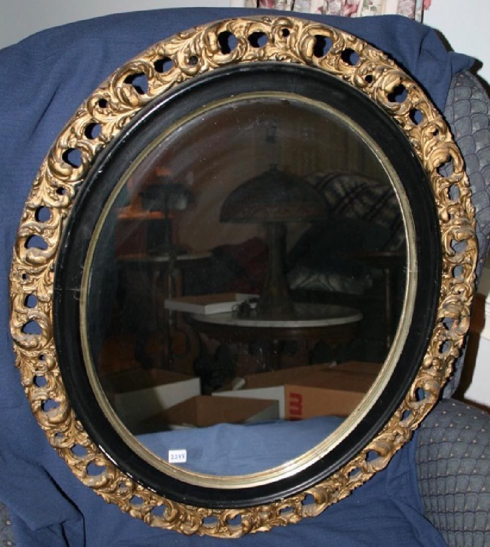 Oval Gilt and Black Painted Mirror