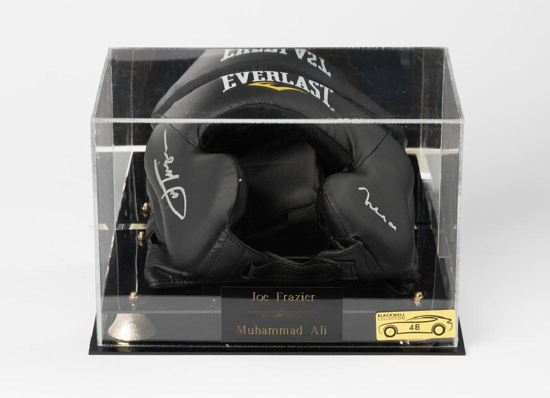 Joe Frazier and Muhammad Ali signed boxing gear