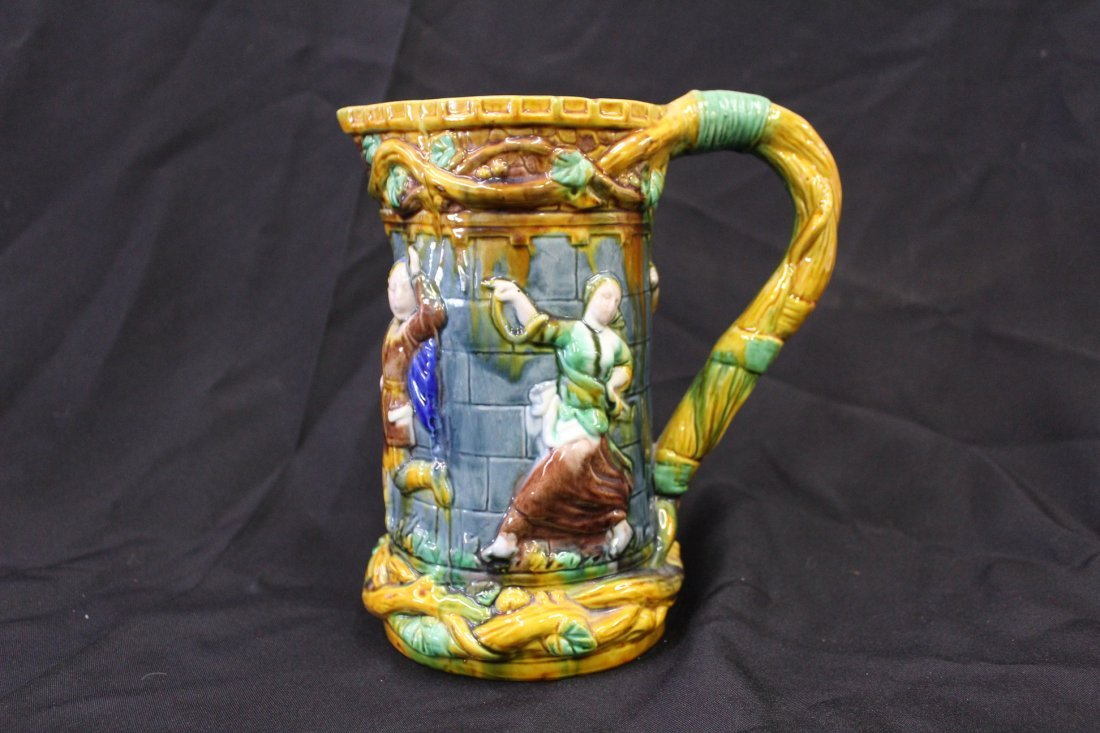 Majolica Pitcher with Bas Relief Figures