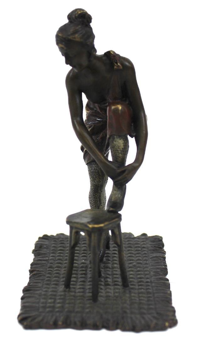 Bronze Figure. Girl on a Stool