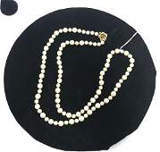 Cultured Pearl Necklace. 14K Gold Sapphire Clasp