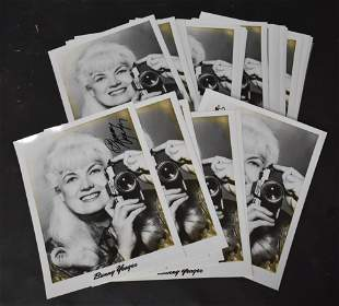 (38) Photos Of Bunny Yeager Holding Camera.