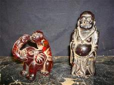 15: TWO(2) AMBER CARVINGS