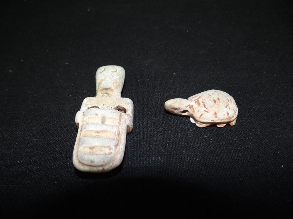 15: TWO CALCIFIED CHINESE JADE PENDANTS