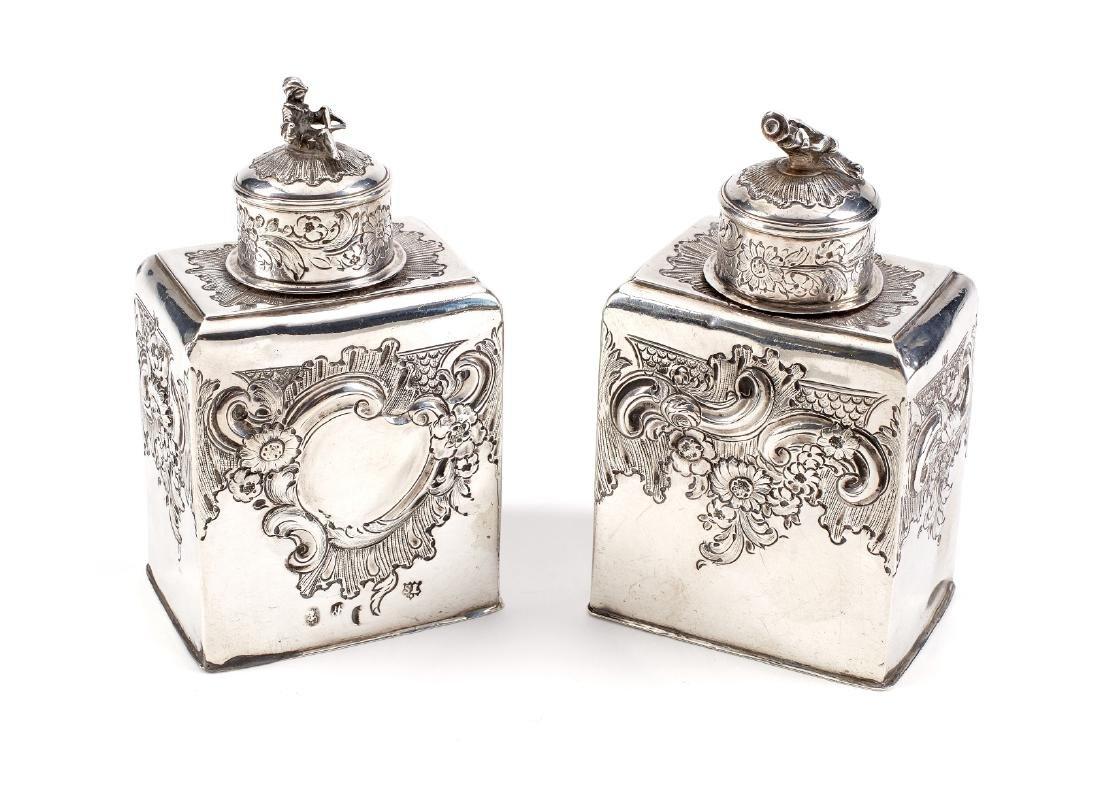 A pair of Queen Anne Britannia standard silver tea