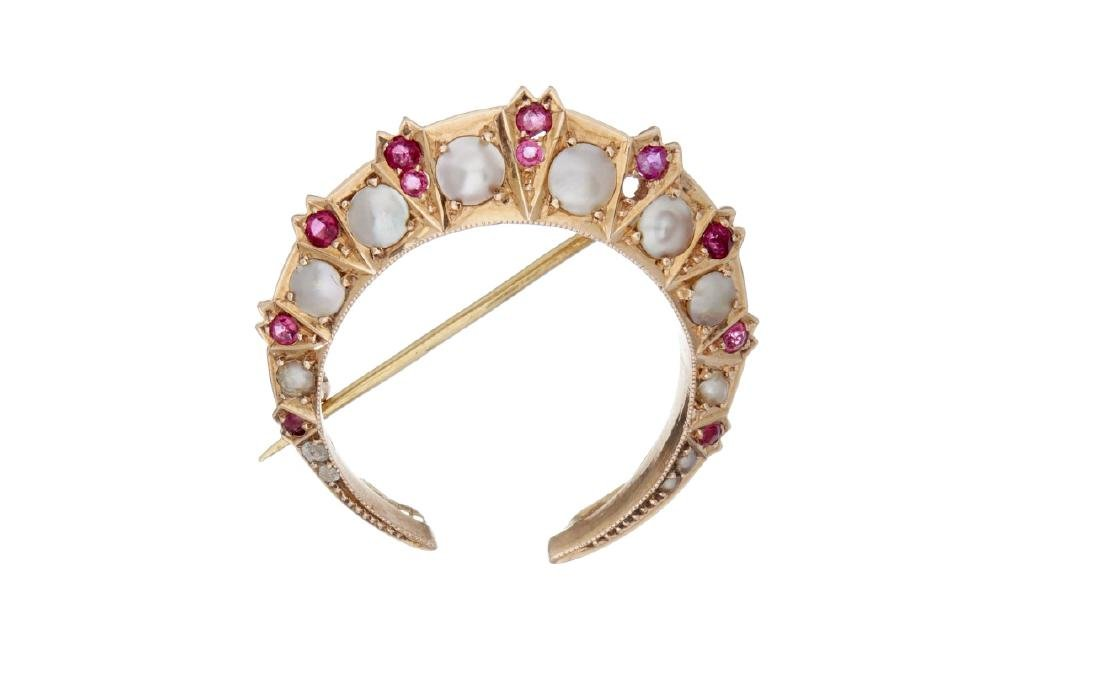 A late 19th century half pearl and ruby crescent brooch