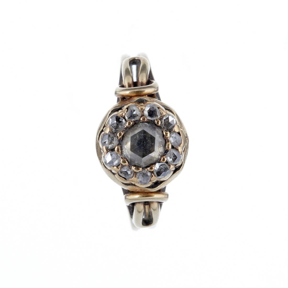 A rose cut diamond cluster ring