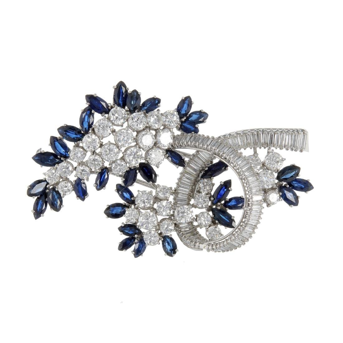 A sapphire and diamond spray brooch