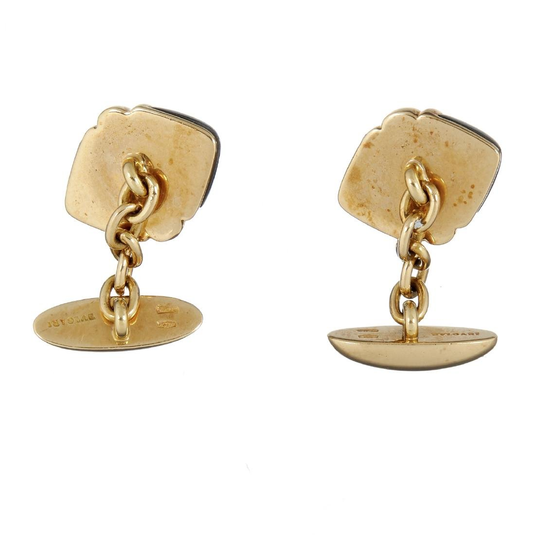 A pair of hematite and gold coloured cufflinks by - 2