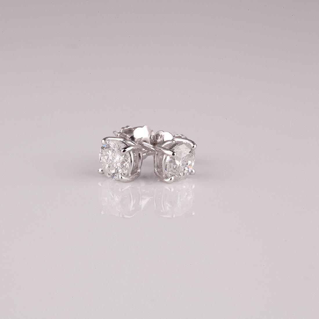 APP: 0.9k *14 kt. White Gold, 0.25CT Round Cut Diamond