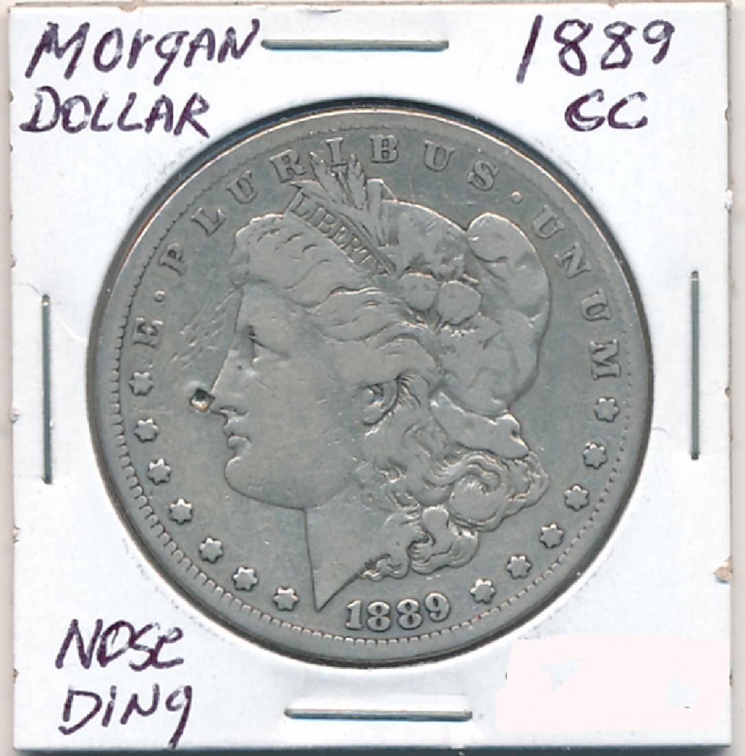 1889-CC Morgan Dollar Nose Ding Coin (JG)