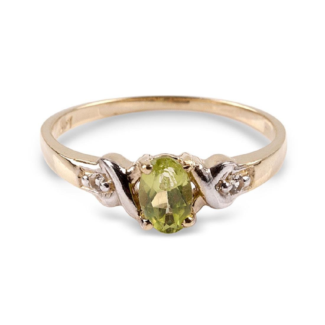 APP: 0.6k 14 kt. Gold, 0.42CT Peridot And White