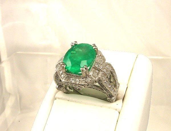 817: APP.: $87.8K, 5.18CT Emerald and 1.16CT Diamond Ri