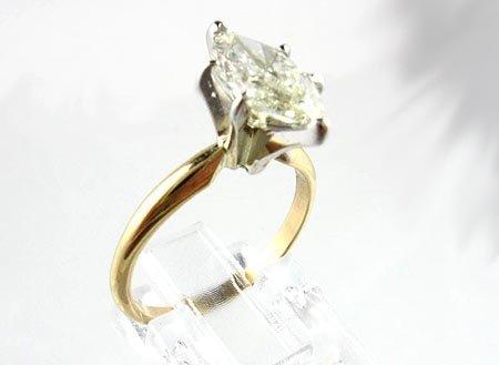 3000: APP.: $14K, 14 kt. Gold, 1.52CT Marquise Diamond