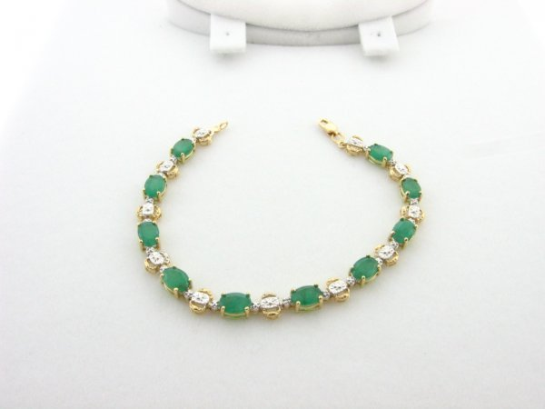 3014: GOV - 8.20CT Emerald and .01CT Diamond Bracelet