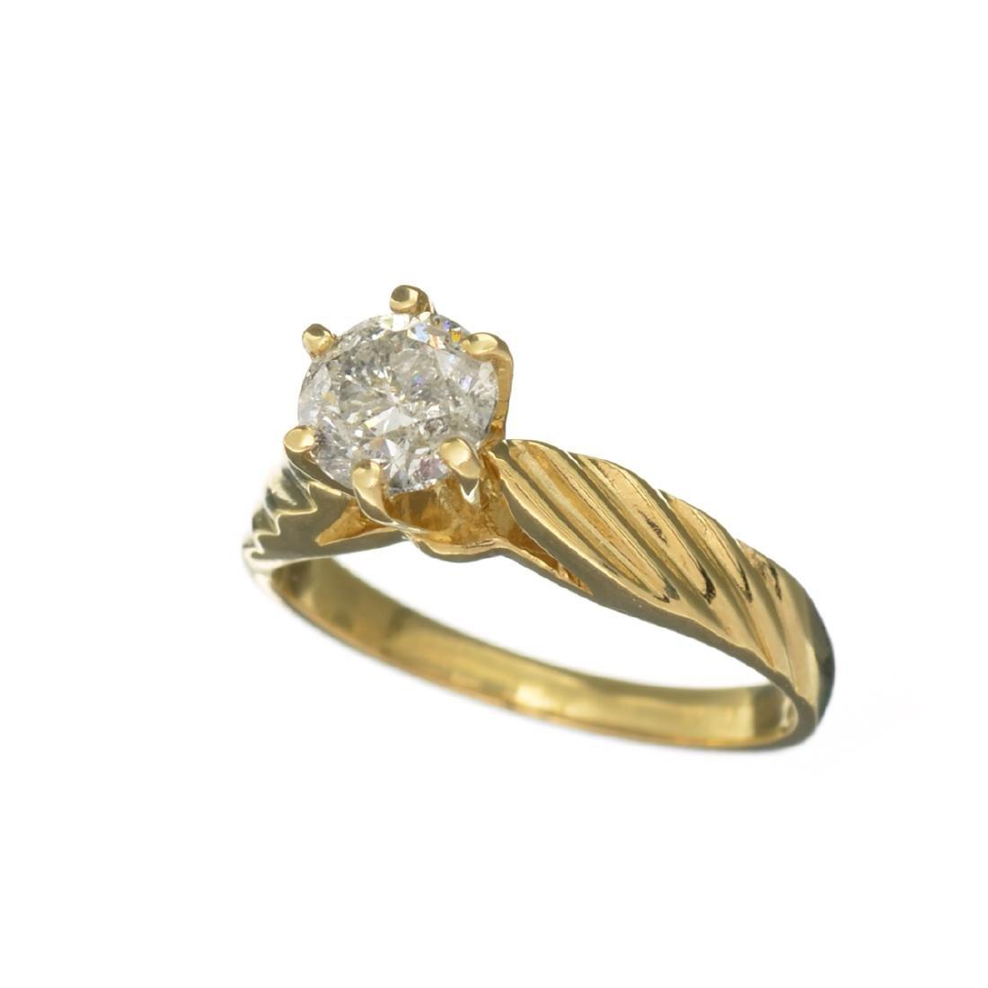 APP: 7.2k 14 kt. Gold, 1.10CT Round Cut Diamond Ring