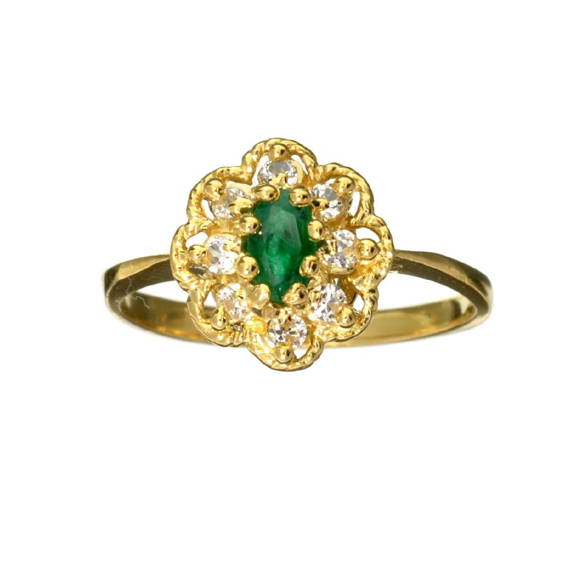 APP: 1k 14 kt. Gold, 0.41CT Oval Cut Emerald And