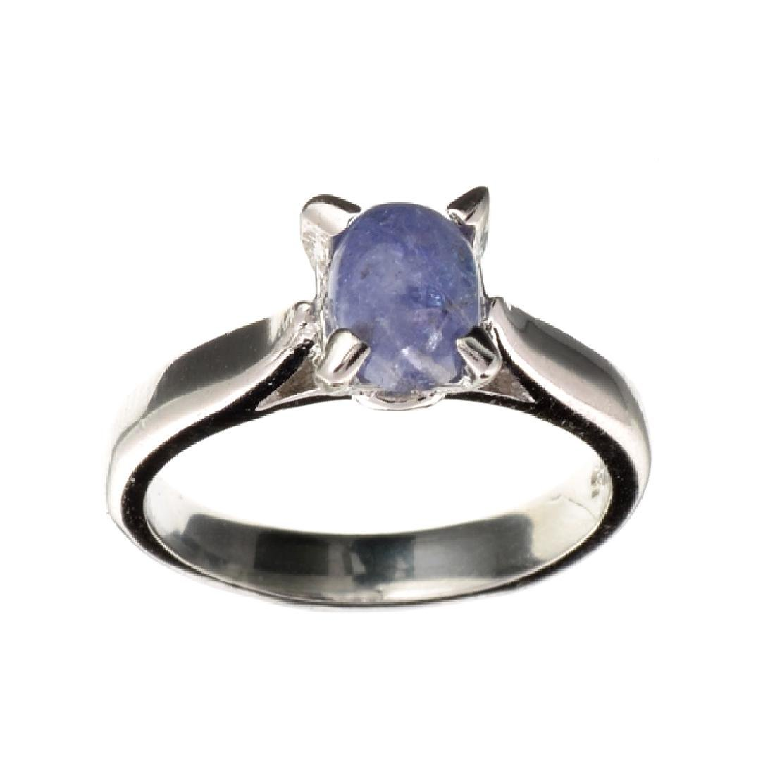 APP: 2.9k 1.03CT Oval Cut Cabochon Tanzanite and