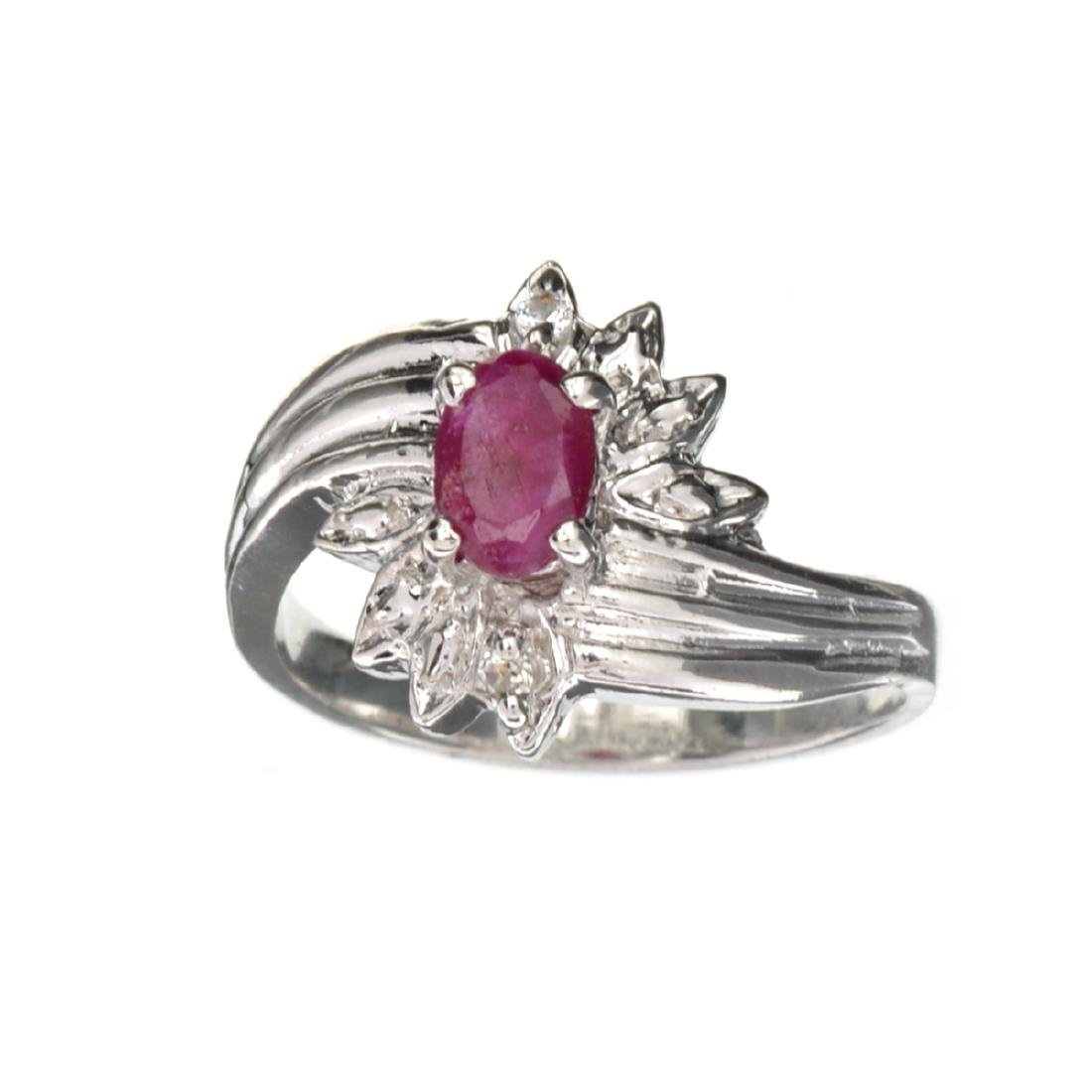 APP: 0.8k 0.60CT Ruby And Topaz Platinum Over Sterling
