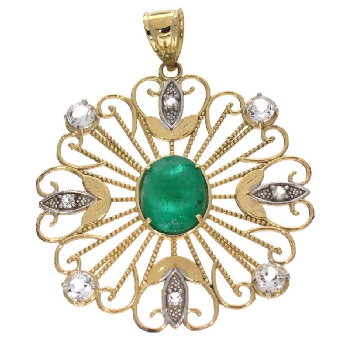APP: 2.9k 14 kt Gold, 2.70CT Emerald and Topaz Pendant
