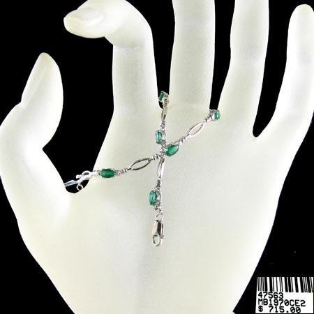 823: 14 kt. White Gold, 1.82CT Emerald and Diamond Brac