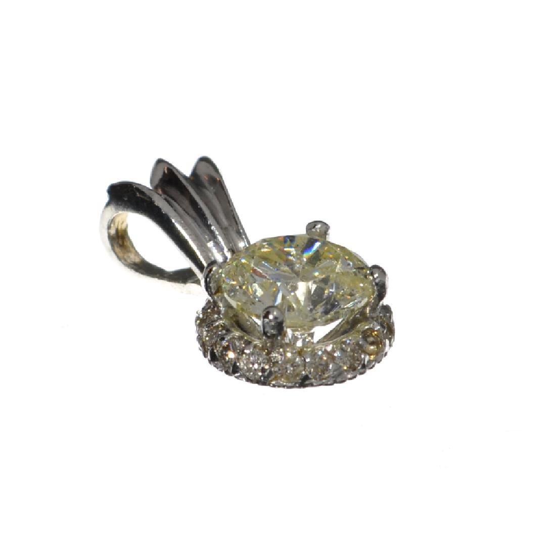 APP: 6.3k 14 kt. White Gold, 1.10CT Round Cut Diamond