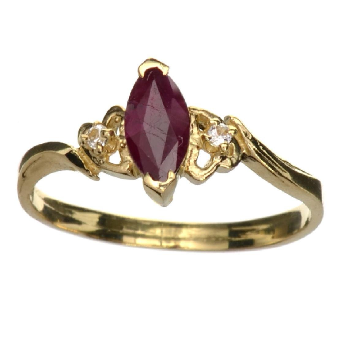 APP: 0.8k 14 kt. Gold, 0.70CT Marquise Cut Ruby And