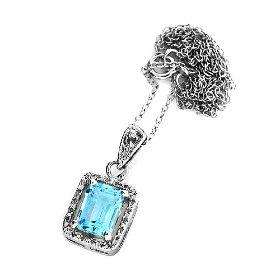 Blue Topaz and Sterling Silver Earring and Pendant Set