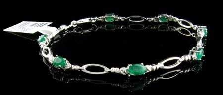 1202: 14 kt. White Gold, 1.82CT Emerald and Diamond Bra