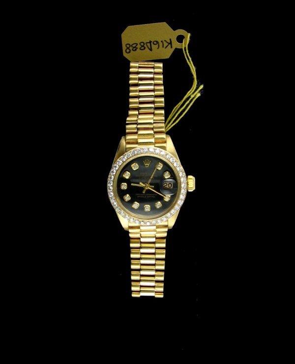 2584: 18kt. Gold, 1.25'' Dia. Ladies Rolex, INVESTORS L
