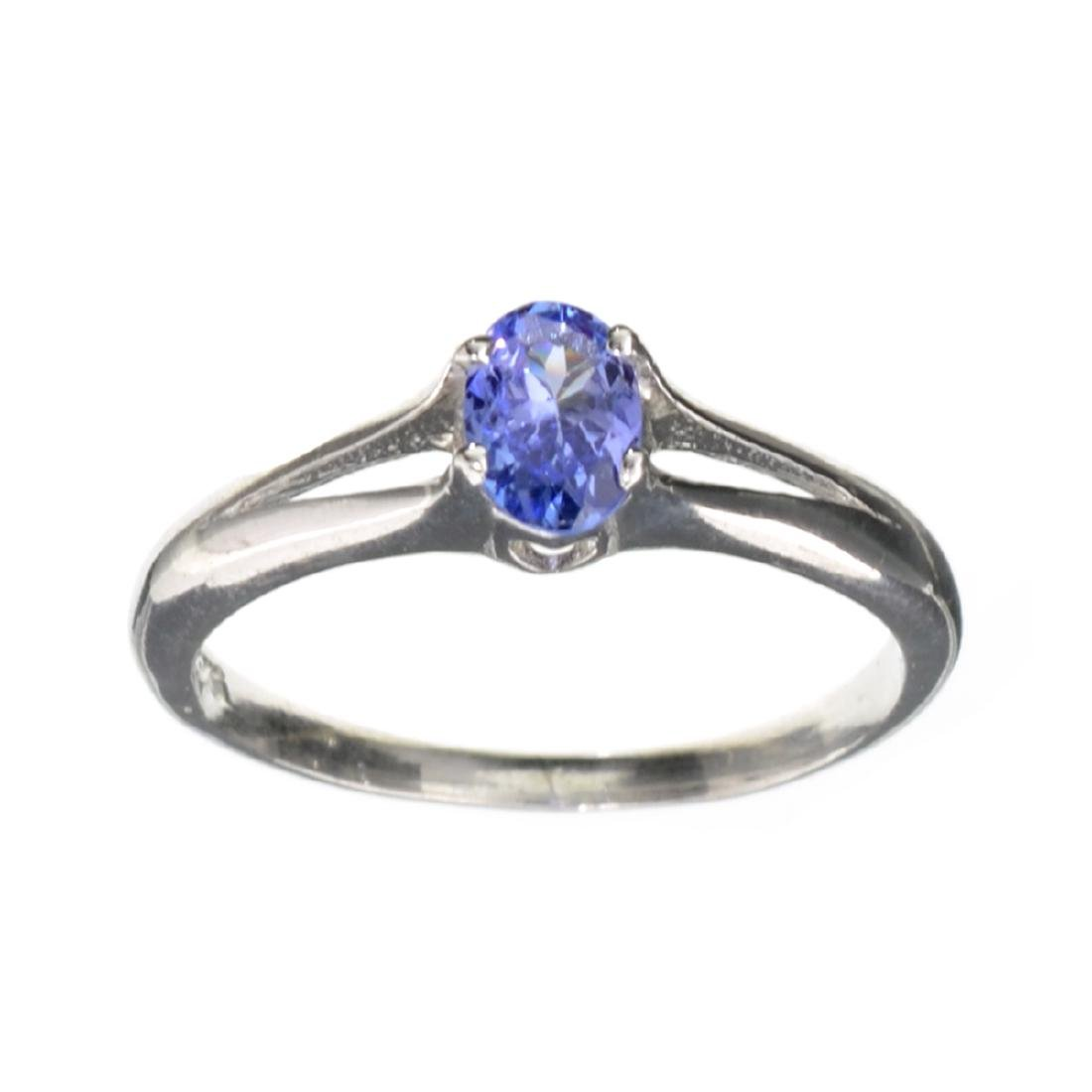 APP: 1k 0.44CT Oval Cut Tanzanite And Platinum Over
