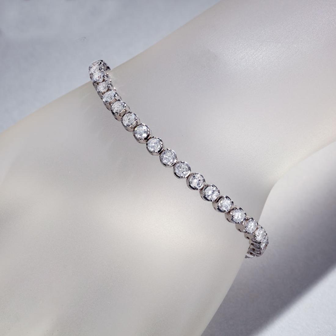 APP: 16.5k *Fine Jewelry 14 KT White Gold, 7.00CT Round