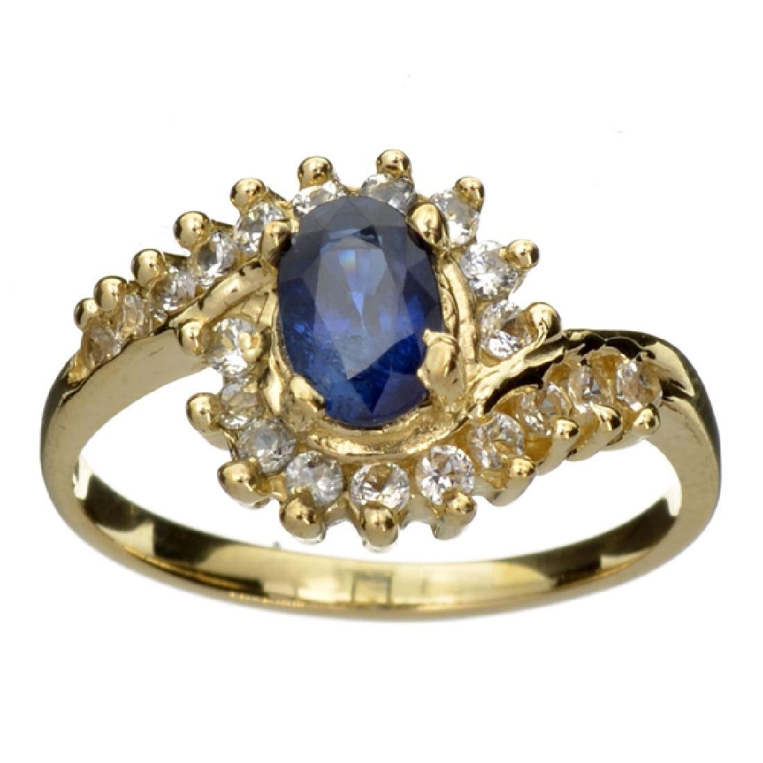 APP: 1.3k 14 kt. Gold, 0.41CT Oval Cut Blue And White