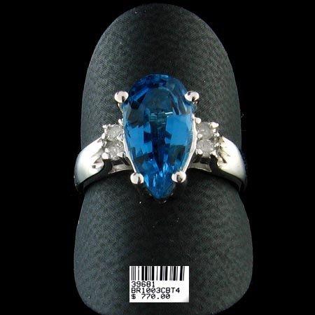5224: 14 kt. White Gold, Blue Topaz & Diamond Ring