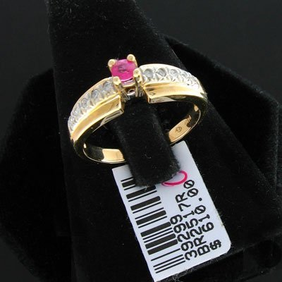 21: 14 kt. White Gold, 0.15CT Ruby and Diamond Ring