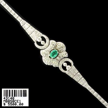 1619: 14 kt. White Gold, 0.84CT Emerald and 1.89CT Diam